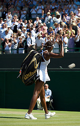 LONDON, ENGLAND - Tuesday, June 29, 2010: Venus Williams (USA) collects waves as she exits Court No. 1 after losing the Ladies' Singles Quarter-Final match on day eight of the Wimbledon Lawn Tennis Championships at the All England Lawn Tennis and Croquet Club. (Pic by David Rawcliffe/Propaganda)