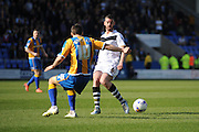 Richard Duffy of Port Vale FC and Shaun Whalley of Shrewsbury Town battle for the ball during the Sky Bet League 1 match between Shrewsbury Town and Port Vale at Greenhous Meadow, Shrewsbury, England on 25 March 2016. Photo by Mike Sheridan.