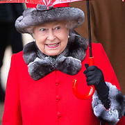 Pic shows The Queen  at Sandringham Church on December 25, 2015 near King's Lynn, Norfolk, for the Christmas Day Service.<br /> <br />  Members of the Royal Family have attended the Christmas Day service at church on the Sandringham estate.<br /> Led by the Queen, who arrived in a Bentley, the royals made their way from Sandringham House to St Mary Magdalene Church for the traditional service.<br /> The other members of the family made the short journey on foot.<br /> Hundreds of well-wishers had gathered in the rain to catch a glimpse of the monarch and other senior members of the Royal Family.<br /> The Queen, who arrived in Norfolk by train last week, wore a red coat and hat with fur trim, and held a matching umbrella.<br /> She returned to Sandringham House by car after the service, but Prince Harry was among those who stopped to speak to members of the public.