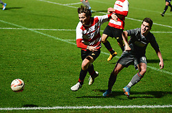 © London News Pictures. 26/02/2014. Doncaster, UK. One Directions Louis Tomlinson (centre) makes his debut for Doncaster reserves against Rotherham at the Keepmoat Stadium in Doncaster 26 February 2014 . Photo credit: London News Pictures.