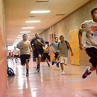 110612       Brian Leddy<br /> Gallup High School students runs sprints down the hall during basketball trouts Monday at the school.