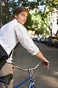Man riding bicycle in residential district close-up