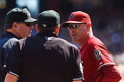 September 4, 2011; San Francisco, CA, USA;  Arizona Diamondbacks manager Kirk Gibson (right) argues with MLB umpire Brian Knight (center) and umpire Hunter Wendelstedt (left) after right fielder Justin Upton (not pictured) was ejected during the fourth inning against the San Francisco Giants at AT&T Park.