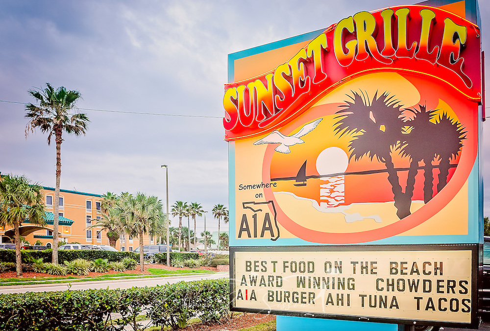 A sign advertises the Sunset Grille, March 19, 2016, in St. Augustine, Florida. The restaurant opened in 1990 and offers a laidback, Key West atmosphere. Signs throughout the building refer to Florida state road A1A, where the restaurant is located. The road runs along the Atlantic Ocean, from Key West to Fernandina Beach, Florida. The historic highway, which is more than 338 miles long, is a designated National Scenic Byway and holds an important place in Florida beach culture. Sunset Grille has popularized the name by using #SomewhereOnA1A, #A1ALife, and #HaveAnA1ADay on social media. (Photo by Carmen K. Sisson/Cloudybright)