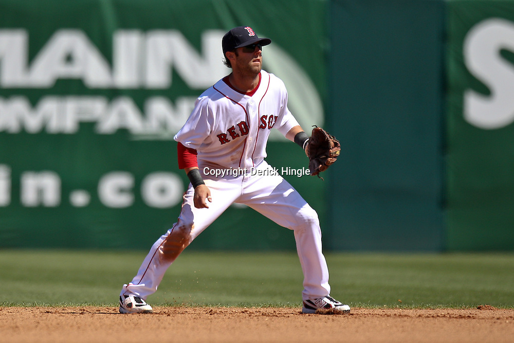 March 12, 2011; Fort Myers, FL, USA; Boston Red Sox second baseman Dustin Pedroia (15) during a spring training exhibition game at City of Palms Park. The Red Sox defeated the Marlins 9-2.  Mandatory Credit: Derick E. Hingle