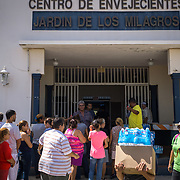 OCTOBER 20 - SANTA ISABEL, PUERTO RICO - <br /> Residents pick up water and supplies in a Santa Isabel  distribution center set up at the makeshift command center for the mayor of the town. City hall sustained heavy damage and is unusable.<br /> (Photo by Angel Valentin/Freelance)