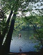 Dan Braden swings out on rope swing near Hanover, NH.