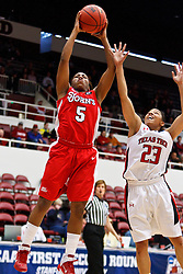 March 19, 2011; Stanford, CA, USA; St. John's Red Storm guard Nadirah McKenith (5) shoots past Texas Tech Lady Raiders guard Monique Smalls (23) during the first half of the first round of the 2011 NCAA women's basketball tournament at Maples Pavilion. St. John's defeated Texas Tech 55-50.