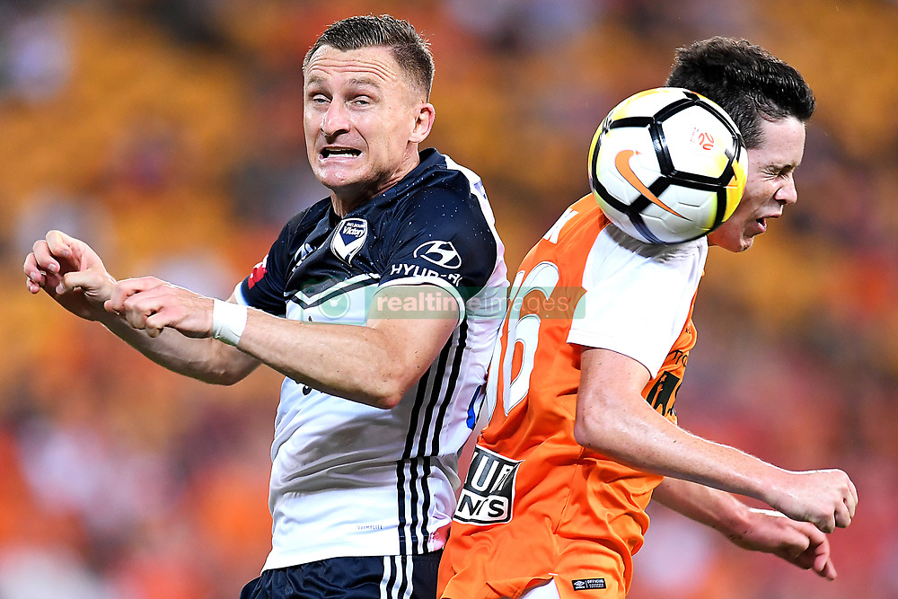 December 17, 2017 - Brisbane, QUEENSLAND, AUSTRALIA - Besart Berisha of Melbourne Victory (8, left) and Mitchell Oxborrow of the Roar (16) compete for the ball during the round eleven Hyundai A-League match between the Brisbane Roar and the Melbourne Victory at Suncorp Stadium on Sunday, December 17, 2017 in Brisbane, Australia. (Credit Image: © Albert Perez via ZUMA Wire)
