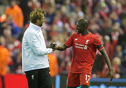 LIVERPOOL, ENGLAND - Thursday, April 14, 2016: Liverpool's manager Jürgen Klopp celebrates with Mamadou Sakho after the dramatic 4-3 (5-4 aggregate) victory over Borussia Dortmund during the UEFA Europa League Quarter-Final 2nd Leg match at Anfield. (Pic by David Rawcliffe/Propaganda)