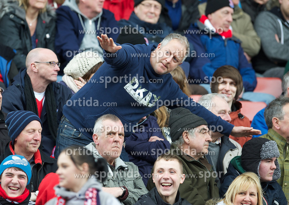14.04.2013, Britannia Stadion, Stoke on Trent, ENG, Premier League, Stoke City vs Manchester United, 33. Runde, im Bild A Stoke City supporter makes an airplane gesture towards the Manchester United fans during the English Premier League 33th round match between Stoke City FC and Manchester United at the Britannia Stadium, Stoke on Trent, Great Britain on 2013/04/14. EXPA Pictures © 2013, PhotoCredit: EXPA/ Propagandaphoto/ David Rawcliffe..***** ATTENTION - OUT OF ENG, GBR, UK *****