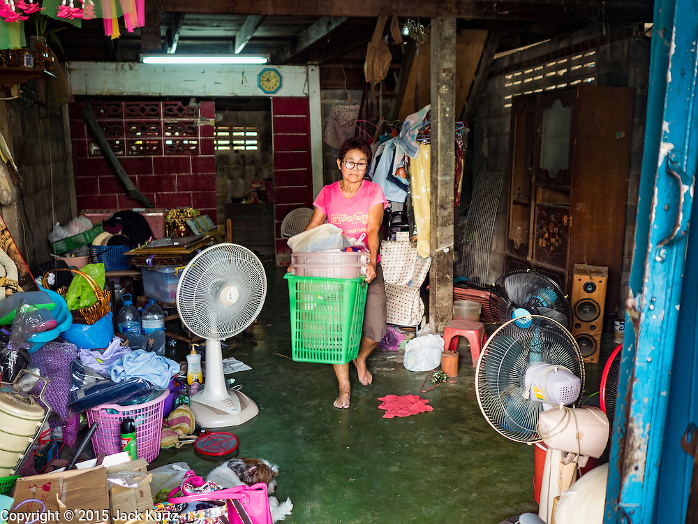 12 NOVEMBER 2015 - BANGKOK, THAILAND:  A woman packs her belongings on the day she was evicted from her home at Wat Kalayanmit. Fifty-four homes around Wat Kalayanamit, a historic Buddhist temple on the Chao Phraya River in the Thonburi section of Bangkok, are being razed and the residents evicted to make way for new development at the temple. The abbot of the temple said he was evicting the residents, who have lived on the temple grounds for generations, because their homes are unsafe and because he wants to improve the temple grounds. The evictions are a part of a Bangkok trend, especially along the Chao Phraya River and BTS light rail lines. Low income people are being evicted from their long time homes to make way for urban renewal.       PHOTO BY JACK KURTZ