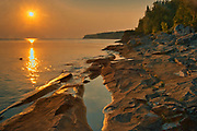 Sunset on Limestone rock along Georgian Bay (Lake Huron) at Little Cove. Bruce Peninsula.<br />