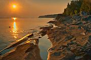 Sunset on Limestone rock along Georgian Bay (Lake Huron) at Little Cove. Bruce Peninsula.<br />Bruce Peninsula National Park<br />Ontario<br />Canada