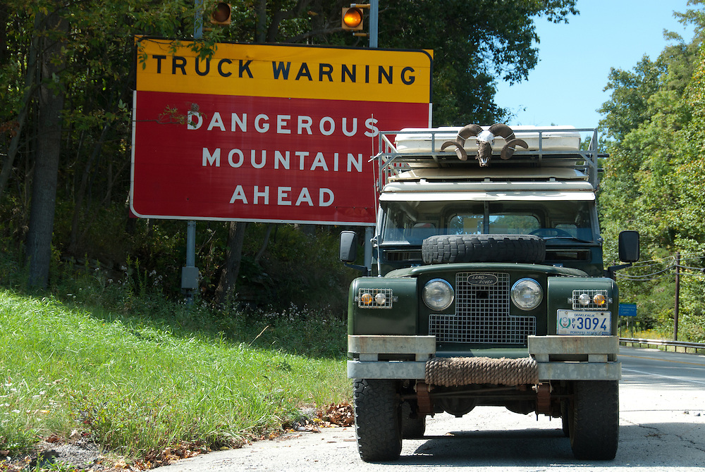 Land Rover by danger sign