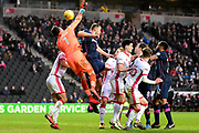 Milton Keynes Dons goalkeeper Lee Nicholls (1) mis-punches under pressure during the EFL Sky Bet League 1 match between Milton Keynes Dons and Portsmouth at stadium:mk, Milton Keynes, England on 10 February 2018. Picture by Dennis Goodwin.