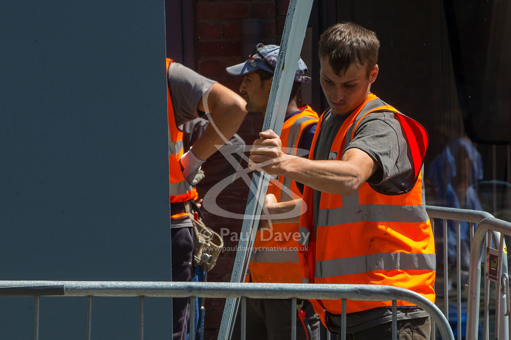 Workers dismantle a TV camera tower on the day following the wedding of Prince Harry to Meghan Markle in Windsor, Berkshire. WINDSOR, May 20 2018.