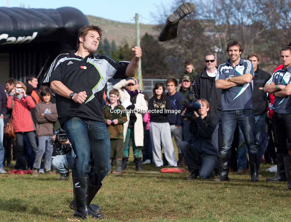 All Black captain Richie McCaw throws a gumboot during the comminty challenge at the Mastercard Roadshow in Taihape,  July 4, 2010. Photo by Nigel Marple