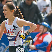 A woman, Caitlin Tormey of New York, competing in the 2007 New York City Marathon.  She finished 13th overall.  Photographed near the 26.1 mile marker.  The race was 26.2 miles long.