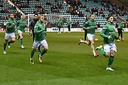 Hibs players warm up for the Ladbrokes Scottish Premiership match between Hibernian and Rangers at Easter Road, Edinburgh, Scotland on 19 December 2018.