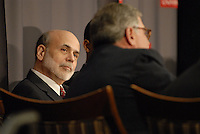 Chairman of the Federal Reserve Board of the United States Ben Bernanke (left) listens to Sam Palmisano (right), President and CEO of IBM, at the 'Conversation on the Economy,' a forum held at Pfahl Hall in the Fisher College of Business at Ohio State on Nov. 30, 2010..