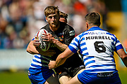 Bradford Bulls scrum half Joe Keyes (7) is tackled during the Kingstone Press Championship match between Halifax RLFC and Bradford Bulls at the MBi Shay Stadium, Halifax, United Kingdom on 2 July 2017. Photo by Simon Davies.