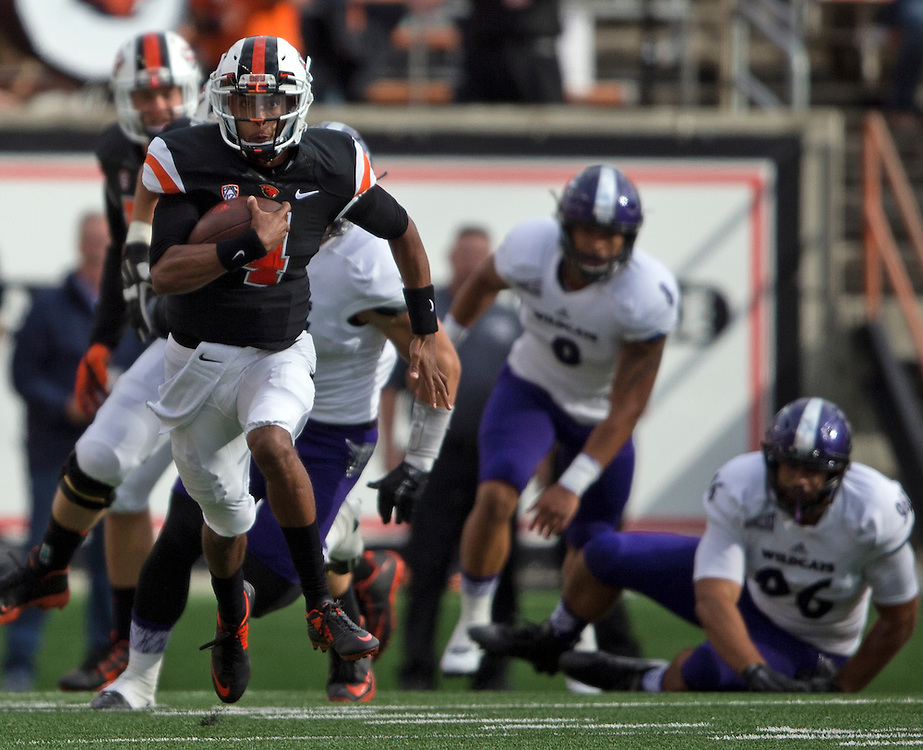 Oregon State quarterback Seth Collins runs through the Weber State defense duringt the Beavers' 26-7 victory in the 2015 season opener in Reser Stadium, in Corvallis, on Friday, Sept. 4, 2015.