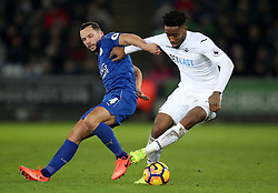 Leicester City's Daniel Drinkwater (left) and Swansea City's Kyle Naughton battle for the ball during the Premier League match at the Liberty Stadium, Swansea.