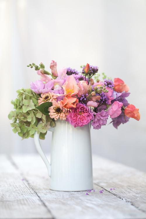 Mixed flower arrangement with Hydrangea, Zinnias, Cosmos bipinatus, Rosa mutabilis, Verbena bonariensis and snapdragon