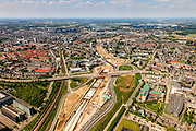 Nederland, Limburg, Maastricht, 27-05-2013; bouwwerkzaamheden voor de A2 traverse, De Groene Loper. <br /> Tunnelbouwkuip Europaplein. Wyck en Ceramique in de achtergrond<br /> De snelweg A2 gaat ondergronds, er wordt een gestapelde tunnel gebouwd (2 wegen boven elkaar). Het plan moet voor een betere bereikbaarheid en leefbaarheid van Maastricht zorgen en ook voor een betere doorstroming op de A2.<br /> Construction works for motorway A2 crossing Maastricht, the so-called Green Carpet.<br /> The A2 motorway goes underground, a stacked tunnel is  built with two roads above each other). The plan should provide better accessibility and traffic flow.<br /> luchtfoto (toeslag op standard tarieven);<br /> aerial photo (additional fee required);<br /> copyright foto/photo Siebe Swart.