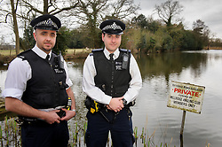 © Licensed to London News Pictures. 22/02/2013 London, UK. PC's Ryan Perry, 38 (left) and Marc Cash, 26 (right) who rescued a woman from a  car submerged in a lake in Totteridge, NW London. The Met Police constables swam out into the freezing water to rescue the unconscious driver, smashing the car windows with a hammer..Photo credit : Simon Jacobs/LNP
