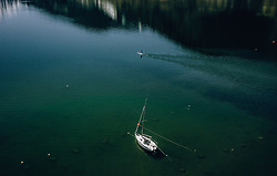 THEMENBILD - ein Segelboot liegt am Zeller See vor Anker, davor ein mann auf einem Stand Up Paddle, aufgenommen am 20. April 2019 in Zell am See, Oesterreich // a Sailboat anchored at the Zeller lake infront a man on a Stand Up Paddle in Zell am See, Austria on 2019/04/20. EXPA Pictures © 2019, PhotoCredit: EXPA/ JFK