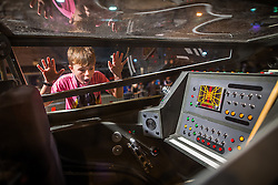 "© Licensed to London News Pictures . 06/12/2015 . Manchester , UK . LUKE PARRY (nine) takes a peek inside an actual X-wing fighter . Fans attend Star Wars exhibition "" For the Love of the Force "" at Bowlers Exhibition Centre in Manchester . Photo credit : Joel Goodman/LNP"