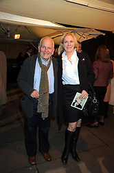 """Actor SIR IAN HOLM and his 4th wife SOPHIE DE STEMPEL at an exhibition of work by Andy Warhol entitled """"Other Voices, Other Rooms"""" at The Hayward Gallery, Southbank Centre, London SE1 on 6th October 2008."""