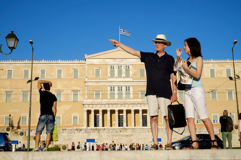 Tourists in front of the parliament building in Athens.