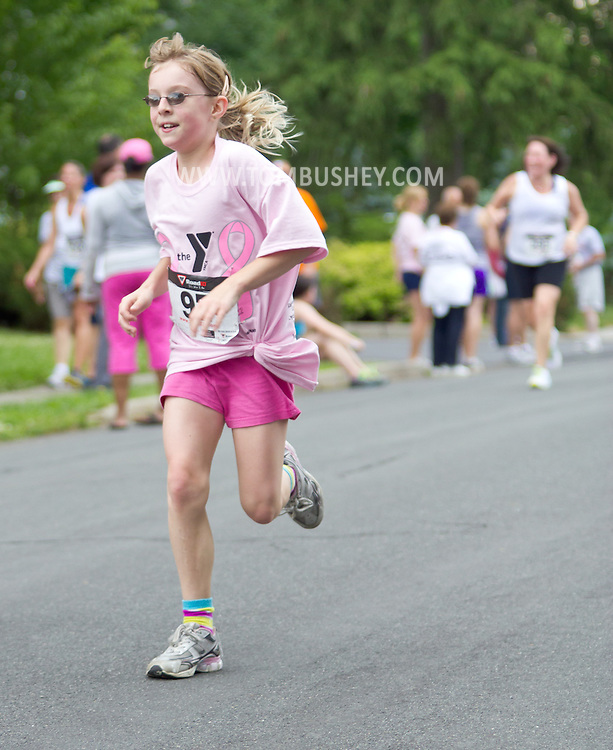 Middletown, New York - A young girl run for the finish line in the 16th annual Ruthie Dino-Marshall 5K Run/Walk put on by the Middletown YMCA on Sunday, June 10, 2012. ©Tom Bushey / The Image Works