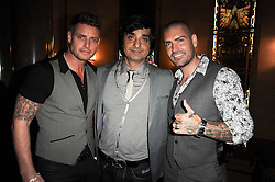 Left to right, singer KEITH DUFFY, Afzal Kahn founder of Project Kahn  and singer SHANE LYNCH at The inaugural Quintessentially Awards held at the Freemason's Hall, Covent Garden, London on 1st June 2010.