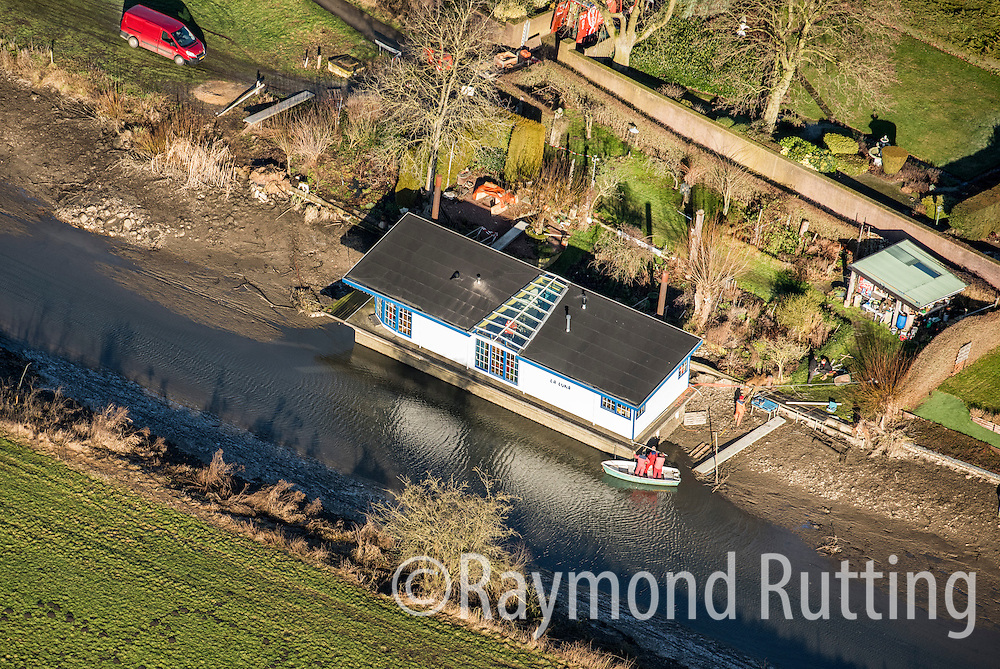 Netherlands - Mook - Low water levels on the Maas River in Mook  ,after damage to stuw / dam at the Thompson Bridge in Grave. A ship carrying hazardous substances including benzene crashed into te John. S. Thompson Bridge over the Maas river in Grave, Noord-Brabant. This Houseboat is in trouble because of the low water level .photo raymond rutting