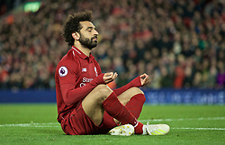 LIVERPOOL, ENGLAND - Friday, April 26, 2019: Liverpool's Mohamed Salah celebrates scoring the fifth goal with a yoga zen pose during the FA Premier League match between Liverpool FC and Huddersfield Town AFC at Anfield. (Pic by David Rawcliffe/Propaganda)