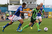Barry Fuller (Captain) of AFC Wimbledon skips past Gary Dicker during the Sky Bet League 2 match between Carlisle United and AFC Wimbledon at Brunton Park, Carlisle, England on 22 August 2015. Photo by Stuart Butcher.