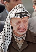 Palestinian leader Yasser Arafat speaks to reporters outside of the White House after meeting with US President Bill Clinton and Israeli Prime Minister Benjamin Netanyahu October 15, 1998 in Washington, DC. Netanyahu and Arafat are meeting in the US to try and revive the Middle East peace accord.