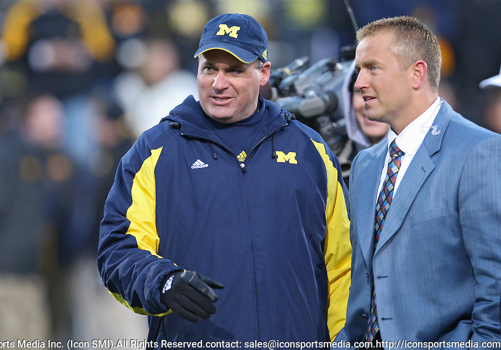 October 10, 2009: Michigan head coach Rich Rodriguez talks with ESPN's Kirk Herbstreit before the Iowa Hawkeyes' 30-28 win over the Michigan Wolverine's at Kinnick Stadium in Iowa City, Iowa on October 10, 2009.
