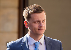 © Licensed to London News Pictures. 08/08/2018. Bristol, UK. RYAN HALE arrives at Bristol Crown court today for the third day of his trial on charges of affray that relate to a fight outside a Bristol nightclub on September 25 2017. England cricketer Ben Stokes and two other men, Ryan Ali, 28, and Ryan Hale, 27, all deny the charge. Stokes, Ali and Hale are jointly charged with affray in the Clifton Triangle area of Bristol on September 25 last year, several hours after England had played a one-day international against the West Indies in the city. A 27-year-old man allegedly suffered a fractured eye socket in the incident. Photo credit: Simon Chapman/LNP