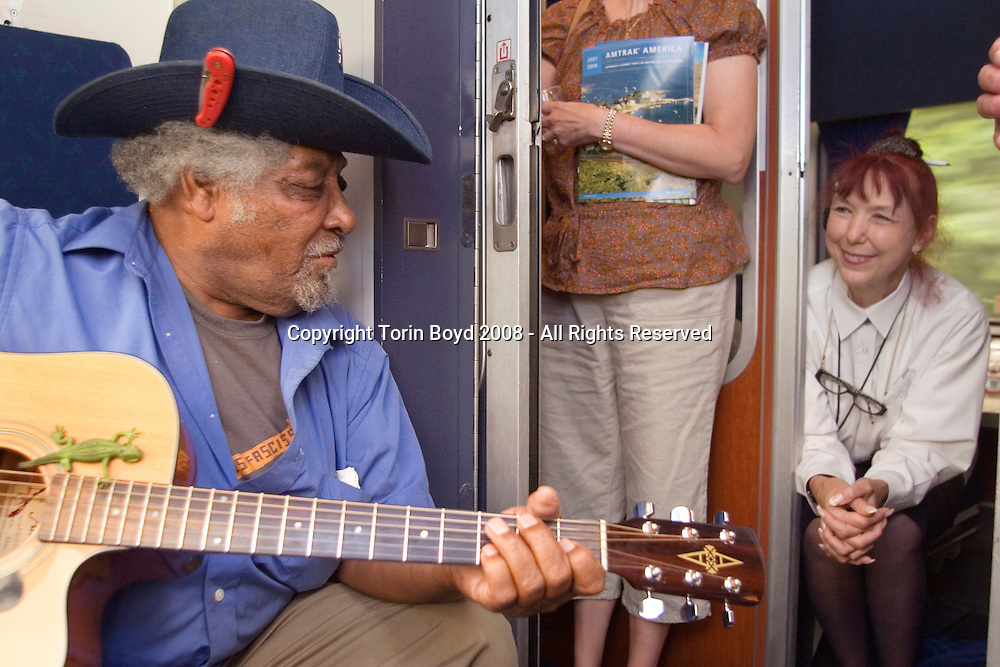 Wisconsin: playing music for passengers and AMTRAK personell during train journey from Washington DC (suburbs) to Washington State with Piedmont Style blues artisrts Warner Williams and Jay Summerour.