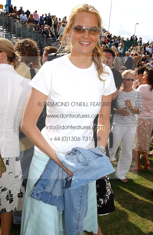 MISS ALICE FERGUSON sister of Sarah, Duchess of York at the Veuve Clicquot sponsored Gold Cup or the British Open Polo Championship won by The  Azzura polo team who beat The Dubai polo team 17-9 at Cowdray Park, West Sussex on 18th July 2004.