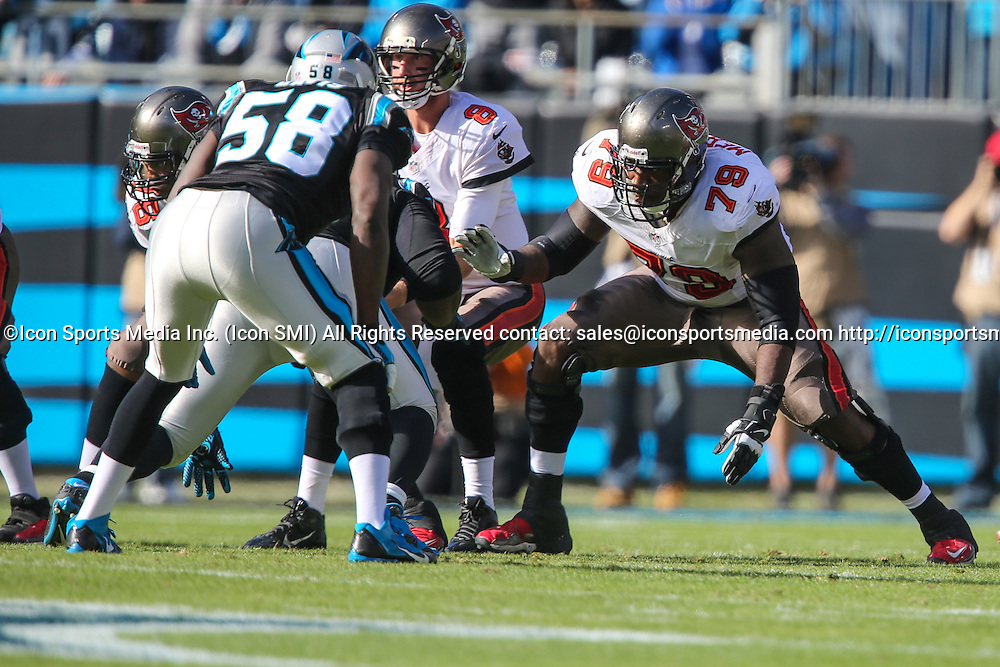 December 1, 2013: Tampa Bay Buccaneers guard Jamon Meredith (79) looks to block Carolina Panthers outside linebacker Thomas Davis (58) during game action at Bank of America Stadium in Charlotte, NC. The Panthers win 27-6 over the Buccaneers.