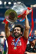 CORRECTION - CHAMPIONS Liverpool forward Mohammed Salah lifts the Champions League Trophy after the UEFA Champions League Final match between Tottenham Hotspur and Liverpool at Wanda Metropolitano Stadium, Madrid, Spain on 1 June 2019.