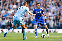 Nemanja Matic of Chelsea is challenged by Edin Dzeko of Manchester City - Photo mandatory by-line: Rogan Thomson/JMP - 07966 386802 - 21/08/2014 - SPORT - FOOTBALL - Manchester, England - Etihad Stadium - Manchester City v Chelsea FC - Barclays Premier League.