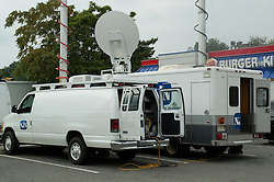 NJN positions mobile coverage of the President's visit in the Burger King parking lot across the street from the Tastee Sub Shop.