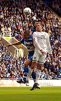Photo: Alan Crowhurst.<br />Reading v Leeds Utd. Coca Cola Championship.<br />29/10/2005. Leeds' Rob Hulse (R) beat the Reading defence to the ball.